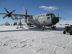 PEGASUS FIELD, Antarctica - An LC-130 Skibird from the New York Air National Guard's 109th Airlift Wing is jacked up on the frozen ice shelf here Jan. 16, 2014 after aircrew discovered a landing gear issue. The maintenance crews of the 109th AW do not have hangars to work out of while deployed to Antarctica for Operation Deep Freeze and must work in the elements and handle unique challenges nearly every day. (U.S. Air National Guard photo by Master Sgt. Kevin Phillips/Released)