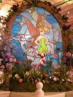 Tinkerbell Stained Glass - I'm betting this is in one of the Disney Parks - Well done.