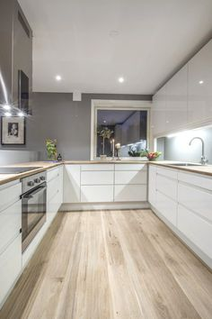 I love this kitchen style and layout, just with a darker wood on the floor and c. I love this kitchen style and layout, just with a darker wood on the floor and counter top. A greyish wood.