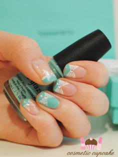 Tiffany & Co nails, this is cute and possible for a wedding, it still has the white but it also has the something blue. Blue white and nude bow nail art with rhinestones