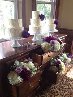 cake stand on vintage dresser with drawers full of flowers, purple and white wedding