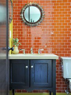 Dark colour furniture unit with bright tiles