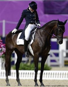 Ingrid Klimke, of Germany, competes during the equestrian eventing dressage phase at the 2012 Summer Olympics, Saturday, July 28, 2012, in London.