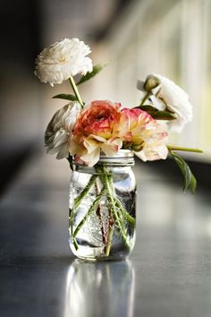 Put your favorite blooms in a mason jar for an easy party (or everyday) decoration.