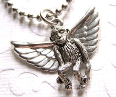 Flying Monkey Necklace Wizard of Oz Inspired Small Silver Plated Metal Kitsch Costume Jewelry. $28.00, via Etsy.