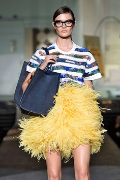 The 10 Milan Fashion Week Trends To Watch #refinery29  http://www.refinery29.com/milan-fashion-week-trends-2014#slide25  Big Bird Skirts Maribou feathers are always a holiday staple, but it might be time to take this plumage for a spin during the springtime, too. Wear it like they styled it on the runways, with a casual T-shirt, or define the waist in another way with a belt. D Squared