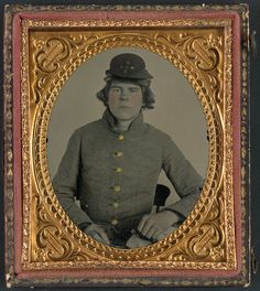 (c. 1861-1865) Young soldier in Confederate uniform with North Carolina state seal buttons and Co. F, 3rd North Carolina Volunteers (13th North Carolina Infantry) Regiment hat