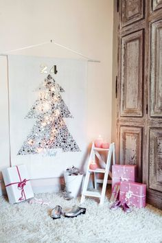 Advent calendar or tree alternative; hearts and stars confetti create sequin-like tree shape; strings lights behind fabric create back lit shimmer; easily hung using existing art hook