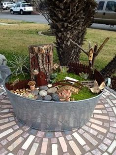 This article loaded with photos explains how to make a fairy garden. I show you step by step how to make your own fairy garden house, fairy garden furniture, and polymer clay fairies. #fairygardening