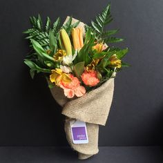"""""""Summer Sunshine"""" - Delivered same-day anywhere in Manhattan* for only $25! Orange Lilies, Yellow Alstroemeria, White Chrysanthemums and Orange Carnations with Leather Leaf Foliage. #orange #yellow #white #green #lily #lilies #alstroemeria #chrysanthemum #carnation #leatherleaf #flowers #florist #petiteposy #newyork #manhattan"""