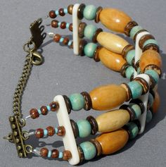 This 3 strand bracelet is made with a variety of wood beads and bone spacers. The clasp is brass and has a chain for adaptability. I think this is a great unisex design that shows Native American and Southwest styling. The bracelet is 8 with a 3 1/2 chain. Casual and comfortable to wear.  Thanks for checking out my shop today. Hope you come again soon.  If you have a custom request please contact me and Ill be happy to work with you.