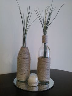 Wine Bottle Centerpiece - Empty wine bottle(with label peeled off), binder twine or thick hemp thread and hot glue. You can also do this with jars, votives, etc. If using votives make sure to use LED flameless candles since using real candles would heat the glass and melt the glue.