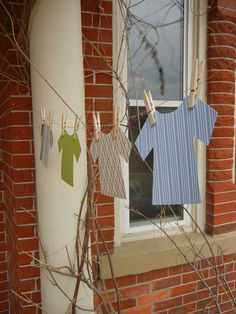 Baby Boy Shower entrance or do one for a girl with real clothes and custom painted clothes pins.