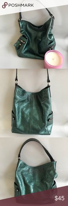 """Tano Emerald Green Bucket Purse Here is a Tano bucket hobo style purse I would say it's an emerald green color It hangs very nice, has 2 it side zippers for extra storage The inside tag is on dark leather and is imprinted Tano Made In Italy No material tag Colorful purse Excellent preowned condition. The handle drop us app 8 1/2 """" The bottom across measures 11"""" and top to bottom is 13"""" Tano Bags Hobos"""