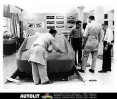 My grandpa far right hard at work in AMCs advanced styling studio on the AMX
