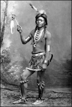 A Shoshone man in Sun Dance attire. Photo taken between 1884 and 1885.