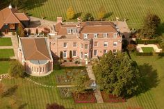 David and Victoria Beckham's 'Beckingham Palace'. See more celebrity homes at http://dspy.me/Hmaoah
