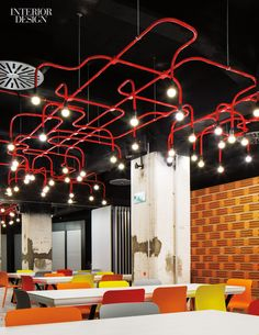 Design Agency added a riot of colorful light fixtures beneath the aluminum…