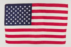 This flag was inside astronaut John Glenn's Friendship 7 Mercury Capsule when he became the first American to orbit Earth. The flag, apparently packed inside the spacecraft, came with Friendship 7 when it was given to the Smithsonian Institution by NASA in 1963.