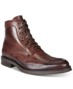 Cap your on-the-town look with a vintage twist in these eye-catching leather boots from Kenneth Cole Reaction. | Leather upper; rubber sole | Imported | Wingtip toe | Lace-up closure with metal eyelet