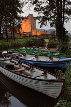 Boats at Ross Castle Killarney Ireland Photograph by Pierre Leclerc