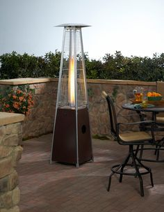 Glass Tower Propane Patio Heater in Antique Bronze You've seen them from LA to Miami at all the chic restaurants and hotels. Now's your chance to finally own one of these beautiful glass tower patio heaters and enjoy it every night but without the Outdoor Heaters Patio, Propane Patio Heater, Fire Table, Paranormal Romance, Outdoor Gardens, Glass, Tube, Quartz, Balcony Ideas
