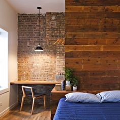 The brick wall, the little desk corner, the warm wood...deep breath...I love it all. #bedroom