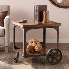 Features:  -Bold, unique look makes a strong statement piece.  -Contrasting wood veneer and metal.  Shape: -Square.  Design: -Table.  Style: -Industrial.  Top Finish: -Mission oak.  Base Finish: -Rust