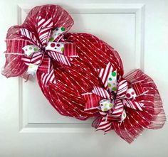 Brightly colored for candyland Christmas Wreath Tutorial. Christmas Mesh Wreaths, Christmas Door Decorations, Deco Mesh Wreaths, Christmas Candy, Christmas Ornaments, White Christmas, Etsy Christmas, Door Wreaths, Ribbon Wreaths