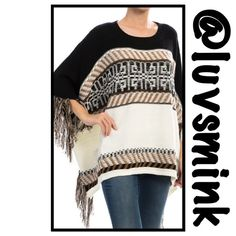 BLACK AND IVORY PONCHO -  SMALL/MEDIUM Pictures cannot depict the beauty of this exquisite, detailed poncho.  Super soft and cuddly warm. A black and Ivory patterned background, with splashes of gold throughout, make this a must have piece for everyone.  55/45 Cotton/Acrylic, length is 39 inches.  Fringe around the sleeves and sides; and a finished knitted edge completes the rest.  No holds or trades; price is firm unless bundled. This listing is for a size SMALL/MEDIUM. debut Sweaters…