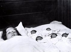 Newborn Dionne Quintuplets with their mother. Born May 28, 1934 in Canada.