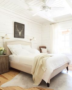 """o land on such a neutral aesthetic. """"Years ago, my 7-year-old nephew asked me, in all seriousness, 'Is plaid your favorite color?'"""" she recalls, laughing about her then tartan-dominated home. """"The next time we moved, I used all white."""" In this photo: Reproduction tea crates serve as nightstands in"""
