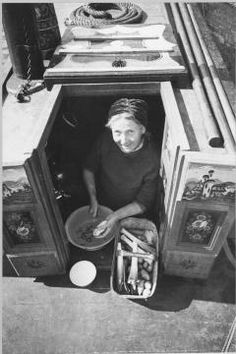 Before the flour is unloaded, Mrs March prepares the vegetables for lunch on board the 'HEATHER BELL'. She stands in the sunshine in the doorway of the barge to peel the potatoes, a basket of leeks and other vegetables beside her. Canal Barge, Canal Boat, Barge Interior, Narrowboat Interiors, Gate Handles, Best Vacations, Running Women, Historical Photos, Britain