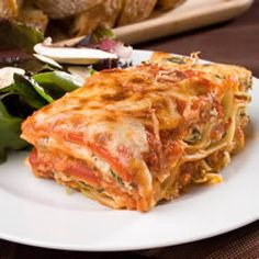 Fresh spinach and plenty of ricotta, Romano and mozzarella make this a cheesy and hearty dish. This lasagna can also be made without the spinach.