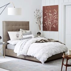 Luxe in leather. Our Tall Grid-Tufted + Plinth Bed Set pairs a lightly-tufted headboard with a solid base frame. In elephant gray leather, its clean and elegant silhouette is sure to turn heads.