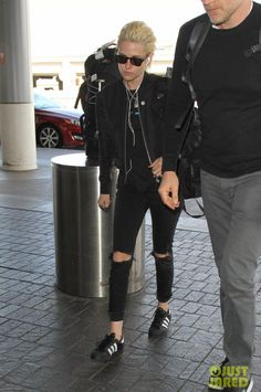 Kristen Stewart wearing Adidas Superstar Foundation Shoes, Saint Laurent Bomber Jacket and Local Authority La Slash Sweatshirt