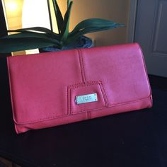 """BCBG Clutch New. Never used. Beautiful blood orange BCBG  envelope clutch. Very classy, very cute. Make it yours! 12"""" x 6 1/2"""". In top condition! BCBG Bags Clutches & Wristlets"""