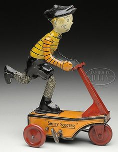 "*SMITTY SCOOTER WINDUP TOY~By Marx USA.Famous comic character boy rides on3wheel windup scooter in circular motion. Character is licensed by Famous Artists Syndicate.SIZE: 8""t. CONDITION: Excellent example of this always elusive toy. Lithograph is very clean. Windup working."