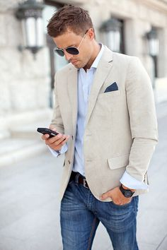 white oxford. light sand blazer. blue pocket square. jeans. brown belt. watch. shades. cool. classic. casual. spring/summer. style.