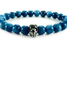 Dizarro to męska biżuteria najwyższej jakości produkowana z kamieni półszlachetnych, srebra, złota oraz kryształów Swarovski™.  Bransoletka wykonana z niebieskich jadeitów oraz srebrnej, rutenowanej czaszki.Szczegóły:- czaszka z rutenowanego srebra próby 925- bransoletka wkładana na elastycznej gumce- średnica kulek: 8 mm- bransoletka zapakowana w eleganckie, czarne pudełko
