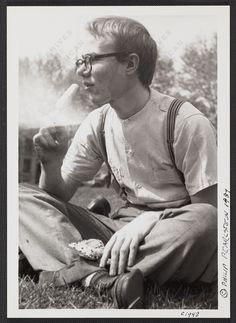 Andy Warhol eating a popsicle, 1948 Photographic print : Creator: Philip Pearlstein (1924-), photographer Description: Date from penned note beneath image. Shows Warhol sitting cross-legged in the grass with a popsicle in one hand. Forms part of: Philip Pearlstein papers, 1949-2009