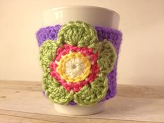 Crocheted Coffee Mug Cozy with Flower.