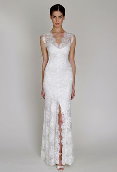Brides: Bliss by Monique Lhuillier. Ivory Chantilly lace V-neck sheath with signature open back and front slitMore Details From Bliss by Monique Lhuillier