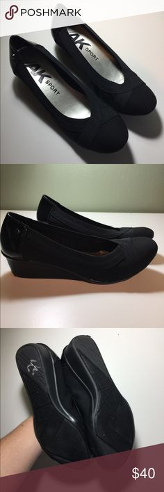 Anne Klein sport black wedge heel shoes 7 1/2 Like New. They are extremely comfy!! I only wore them one time and it was inside. They still look brand new. They fit like a slipper/ ballet flat. Black fabric w/ elastic band detail and patent leather on heels. Wedge sole is a soft rubber.  Size 7 1/2 Anne Klein Sport Shoes Wedges