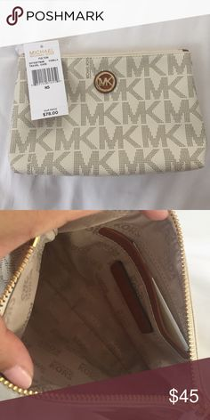 Michael Kors cosmetic bag White PVC Michael Kors cosmetic bag. No scratches. No stains. Never used. Michael Kors Bags Cosmetic Bags & Cases