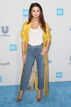 Selena Gomez adds a touch of sophistication for the carpet by pairing her jeans, tee, and trench with a pair of tan stilettos