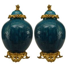 Pair Of Turquoise Porcelain And Bronze Dore Chinoiserie Vases   From a unique collection of antique and modern vases at http://www.1stdibs.com/furniture/more-furniture-collectibles/vases/