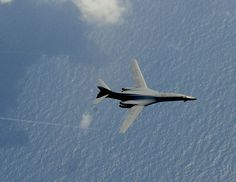 A B-1B Lancer flies over the Atlantic Ocean before refueling from a KC-135 Stratotanker on July 31, 2012.