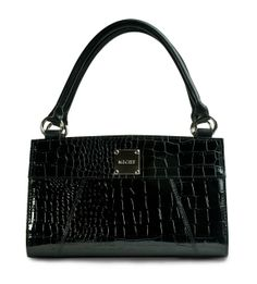 *Miche Canada* The go-to Classic Shell for the career woman on the go, Ella is all about class, style and high fashion. That's why this design is one of our perennial best-sellers. It is a transition piece that can move smoothly from workplace to an evening at the opera and is perfect for any season of the year. Ebony-hued and crocodile-textured with a high gloss finish, Ella is a must-have for your Classic Shell collection.