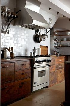 I love the antique look of these wood cabinets. This would be pretty on the pantry wall.  #kitchen
